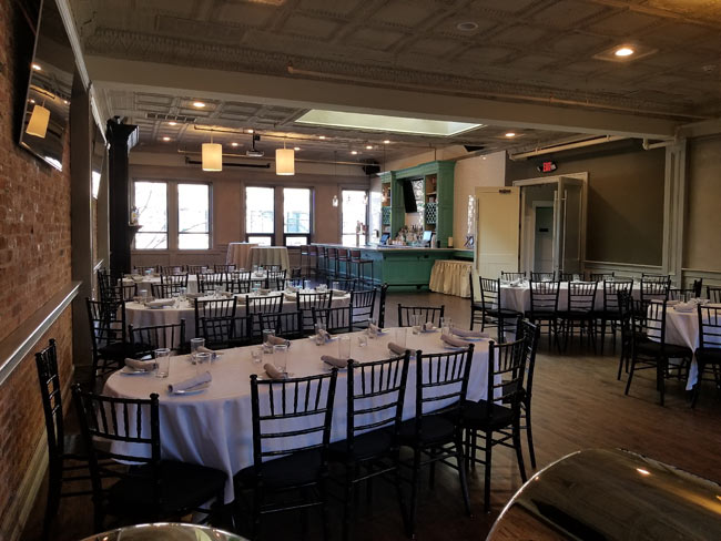 Upstairs Private Party Room photo showing large banquet tables.