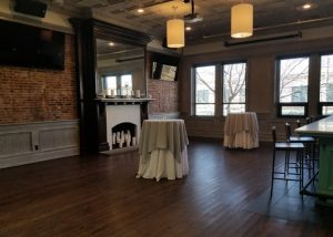 Upstairs Catering Room with Large Fireplace and Bar area overlooking Main Street.